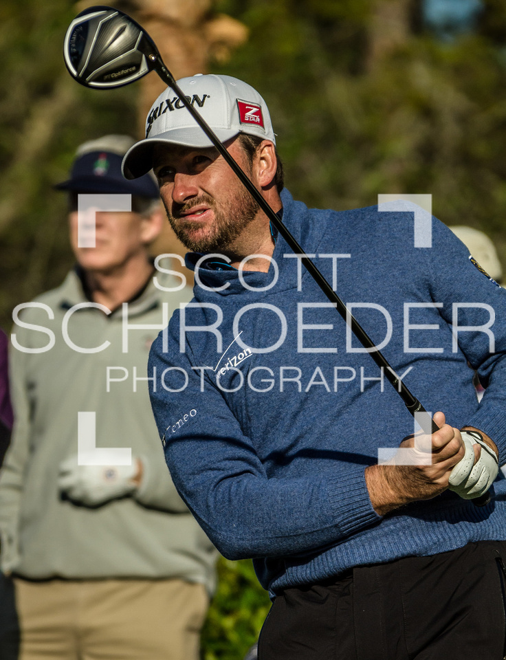RBC Heritage defending champion, Graeme McDowell, watches his shot on a chilly Wednesday morning
